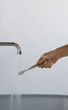 A toothbrush that redirects water into a fountain stream to easily rinse and spit without a cup..GENIUS!