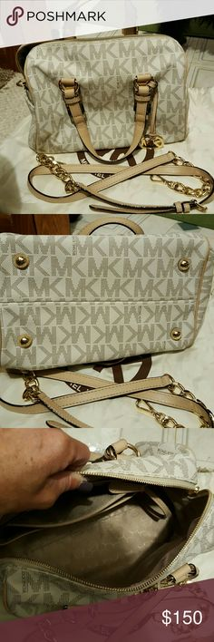 Michael kors handbag Authentic  vanilla MK handbag.   Barely  used. Great condition.  No marks on outside of bag.  Very very  small pen mark inside on bottom. Michael Kors Bags Satchels