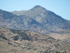https://flic.kr/p/9XBr7A | Zoom shot of Mt. Davidson (el. 7,864ft.) which rises to the west of Virginia City. The famous Comstock Lode silver deposit which changed U.S. & world history, runs L to R along base of peak at center. Facing NW from Hwy 50 near Dayton NV, USA 6-24-2011 | Mount Davidson (el. 7,864ft.) is the highest mountain in Storey County, Nevada, as well as the Virginia Range. The mountain forms a backdrop for the mining boomtown of Virginia City, Nevada which was built above…