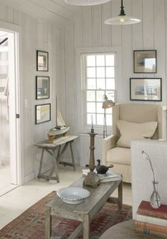 find an old dated house with paneling and paint it distressed white.....