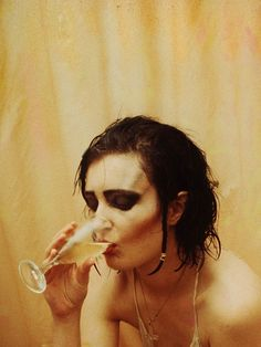 [Siouxsie in the shower, drinking champagne]