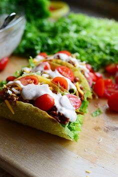 Salad Tacos ... and yes it has beef ! The difference is how it is put together and the yummiest spicy dressing you have ever tasted !