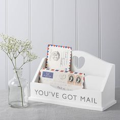 Letter Rack finished in a lovely matt white paint with the words 'You've Got Mail' stylishly added on the front.This lovely white wooden Letter Rack is so simple yet so stylish. Whether it reminds you of Rom Coms or it just solves your where do you put your letters problem we guarentee that you will love this product. You can place on your hall table, in the kitchen or as we have done on our work desk as an organiser this lovely shabby chic Letter Rack will raise a smile but fit in easily to…