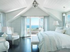Light blue in bedroom with geometric ceiling to bring the eyes up and make the room feel bigger.
