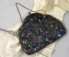 Not that I NEED another vintage evening bag... but this one's so pretty!