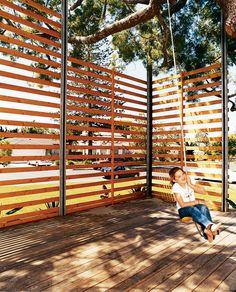 Custom built steel-frame wood screen shaded by a wonderful tree. via dwell