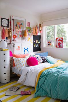 can't tell whether a super colorful bedroom makes it easier to get out of bed . . . or even harder, because who would want to leave this happy place?teen bedroom