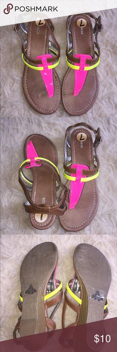 "Express neon strap and leather sandles These sandles have a neon pink and yellow strap and otherwise the sandle has leather upper. Just about 2"" heel. Express Shoes Sandals"