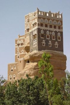 Dar Al Hajar, Yemen, Asia. ~ Dar al Hajar seems to grow out of the rocks. Walking up the many stairs brings you to various rooms: the kitchen, storage rooms, rooms for women, meeting rooms for high placed persons and friends of Imam Yahya who built the palace as a summer residence in the 1930s.