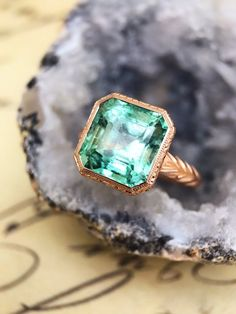 Colombian emerald and hand carved rose gold ring