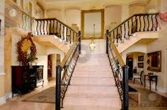 homes with double staircase - Google Search