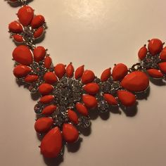 """Orange statement necklace New. Orange/red color. Metal is zinc alloy. Length is about 19-21"""". No trades Jewelry Necklaces"""