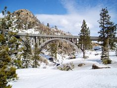 An old fashioned bridge in the Sierra Nevada is an iconic sight and a photographer's dream. It over looks granite boulders and windswept trees near Truckee. California Attractions, California Destinations, Lake Photography, Cityscape Photography, Landscape Photography, Truckee California, Northern California, Yosemite National Park, National Parks