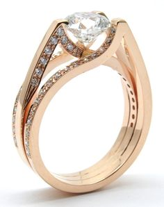 Insane Tension Set Architecturally Inspired.Rose Gold Diamond Engagement ring, with the lines and modern clean style that commands attention.   This is a showstopper.At PureDiamond.ca we have unparalleled friendly service. If you're in the Greater Vancouver area please call (604) 563-9875 to book an appointment.