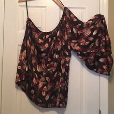 Bebe one shoulder silk blouse So fun and flirty blouse from Bebe. Tie that goes around waist and bronze beading around the top. Super cute with jeans or leggings! The sleeve is Flowy and fun! Size L. Make an offer! Must go! bebe Tops Blouses