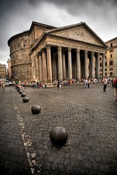 Pantheon, Rome - commissioned by Marcus Agrippa during reign of Augustus 27 BC-14 CE; rebuilt by Hadrian c125-128. Classic Romanized Greek portico introduces, but also disguises, cylindro-spherical interior. Dedicated to deities of the known planets, building posits statement on the physical and philosophic nature of the universe.