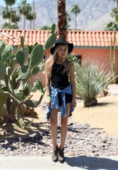 festival fashion at coachella, where tying shirts at the waist suddenly becomes incredibly fashionable