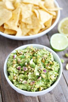 Pistachio Guacamole Recipe on http://twopeasandtheirpod.com  This is my favorite guacamole recipe! It is great as an appetizer, snack, and goes great with any meal!
