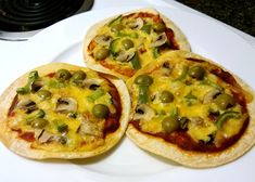 Corn Tortilla Pizzas - Fructose Friendly; Gluten Free- substitute tolerable ingredients. The recipe contains a link for homemade pizza sauce.
