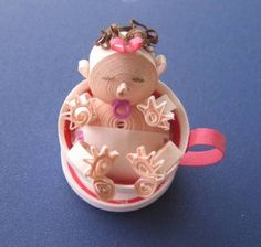 Baby in a teacup - Quilled Creations Quilling Gallery. OMG what creativity.