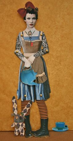 Alice in Steamland is a digital collage paper art doll. She comes with interchangable hands holding either a pocket watch or a teapot. Her friend