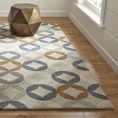 Shop Destry Wool Rug.  A vintage shirt pattern inspired Destry's casual geometric pattern of diamonds and circles, rendered in soft greys, ochre and cream.