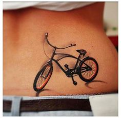Realistic bicycle tattoo on woman's waist.