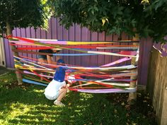 """Old material that has been cut into strips and sewn back together makes for a fabulous soft, springy spiderweb to climb through - from Elder Street Early Childhood Centre ("""",)"""