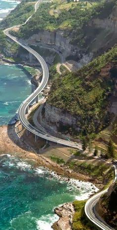 To cruise down the Grand Pacific Drive. | Here: Sea Cliff Bridge, New South Wales, Australia.