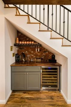 Genius Under Stairs Storage Ideas For Minimalist Home 21 Understairs Storage Genius home Ideas Minimalist stairs storage Under Basement Stairs, Bar Under Stairs, Under Stairs Cupboard, Kitchen Under Stairs, Basement Ceilings, Basement Bars, Under Stairs Storage Solutions, Storage Under Stairs, Tiny House Stairs