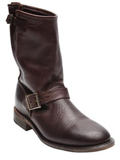 Veronica mid boot in chocolate from Vintage Shoe Company. This leather biker slip-on boot features a round toe, double side buckles, and distressed stacked wooden sole and heel. Heel measures 1.25
