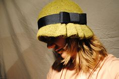 A lightweight cloche hat with a pleated brim.