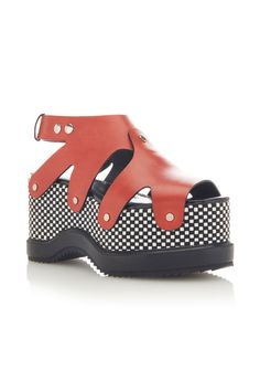Graphic and grippy, these colorful flatforms will carry you through the day in style.  $1,050, proenzaschouler.com.