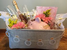 Engagement gift basket! Champagne & glasses, honeymoon fund piggy bank, calendar/planner, and heart shaped cookies