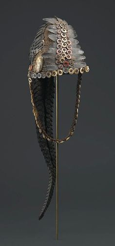 Africa | Bwami hat for Ngandu or Yananio Level.  Lega people of DR Congo (Maniema or Sud-Kivu Province) | Plant fiber, mollusk shells, cowrie shells, buttons, pangolin scales, and pangolin tail | ca. late 19th to early 20th century