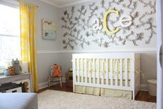 The mural above the crib is made with toilet paper rolls - wow!