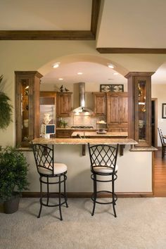 Adding a snack bar to your kitchen opens up the Kitchen and great room floor plan. For more information visit www.carstensenhomes.com