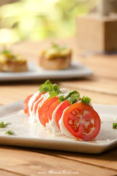 Caprese Salad is an Italian vegetarian salad with tomato, buffalo Mozzarela cheese, basil and olive oil. Learn how to make the caprese salad