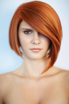 Bright and alluring copper hair color, easy to maintain with regular color refreshing and an sleek sexy, asymmetrical bob ideal for any face shape.
