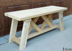 Build a cute little DIY outdoor bench for your porch or entry. Use 2x4's (and 2x3's) to build it for only about $13!!! Free plans #WoodworkingBench