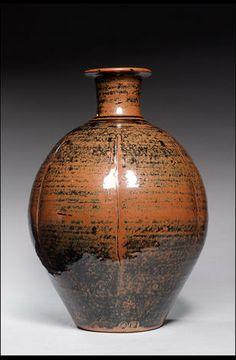 Bernard Leach, Vase, kaki-Tenmoku glaze, vertical iincised line decoration.