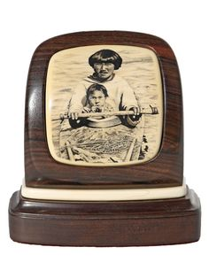 """Eskimo and Child"" Black and white scrimshaw on ancient mammoth ivory by Terry Nelson. A very rare piece done by Nelson sometime between 1982-92. Her work is prized and coveted by knowledgeable collectors far and wide. Regarded as one of the finest portrait scrimshanders in contemporary scrimshaw, her stipple work was among the very best.  Size: 4""W x 2""D x 4""H Price: $4,850.00 -- on ScrimshawGallery.com #scrimshaw"