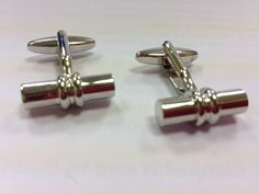 A pair of silver toned bar stainless steel cufflinks.  Approx 20 x 5mm. Priced at $58.