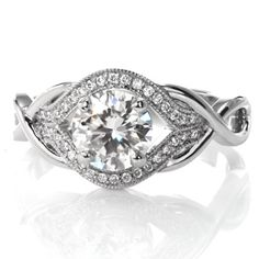 Design 3298 - Featuring a 1.00 carat round brilliant cut center diamond, this elegant design has a unique, woven band. The loops of the ring form infinity signs to symbolize your endless love for each other. Dazzling side diamonds surround the center in a pulled halo. http://www.knoxjewelers.biz/products/design-3298