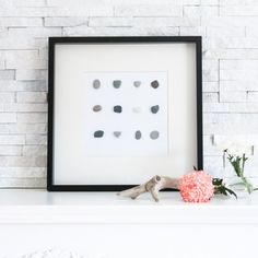Looking for a quick, creative and inexpensive way to freshen up your wall decor? Create some fun and simple DIY wall art using beach stones!