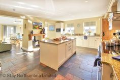 Spacious Kitchen through to diner with double sided log burner Open Plan Kitchen Living Room, Open Plan Living, New Kitchen, Kitchen Decor, Double Sided Log Burner, Hastings House, Log Burning Stoves, Kitchen Models, Wood Burner