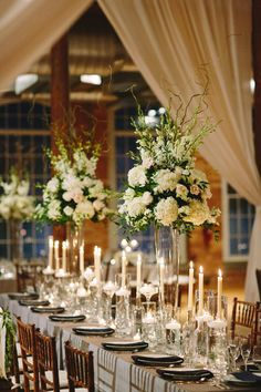 Spectacular combination of #Rustic and #Elegance! #Centerpiece #Candles | See the wedding on #SMP -  http://www.StyleMePretty.com/2014/01/10/the-cotton-room-wedding/ Julia Wade Photography