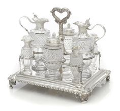 An assembled George III/IV sterling silver and cut-glass  eight-bottle cruet set with stand by Paul Storr, London,  most pieces dated 1816-1817, one bottle later, possibly marked for Phillip Rundell, London, 1822. AUCTION 22389: FINE FURNITURE, SILVER, DECORATIVE ARTS & CLOCKS 4 Mar 2015 10:00 EST  NEW YORK