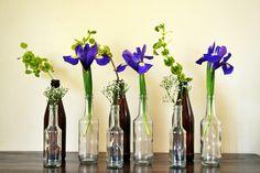 Iris, Irish bells and babies breath in bud vases: flower arrangement