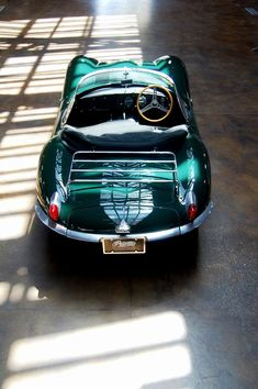 Jaguar.  The colour, the curves, the wooden steering wheel, the luggage rack... the COLOUR (I may have said that already).  I just need a headscarf and some dark glasses to go with...